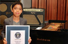 Ethan Bortnick Receives His Official Certificate as the Youngest Musician to Headline a Solo Concert
