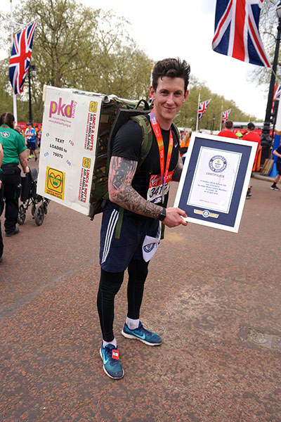 The fastest marathon carrying a household appliance (white goods) is 5 hours 49 minutes 37 seconds by Richard Gray at the London Marathon 2018