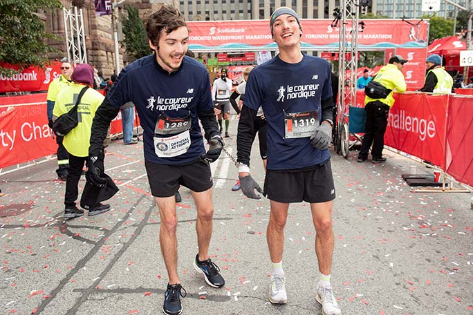 The fastest marathon with two runners hand cuffed together (male) is 3 hours 15 minutes 42.5 seconds by Victor Frève-Boucher and Freüd Fortier-Chouinard at the Toronto Waterfront Marathon in 2018