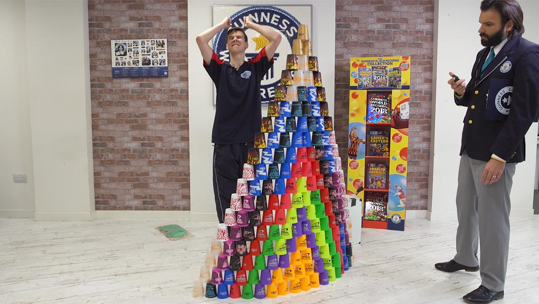 Watch this sport stacker set a lightning-fast cup pyramid record