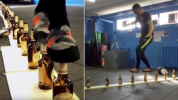 Video: Italian attempts to walk 10 metres on glass bottles for world record