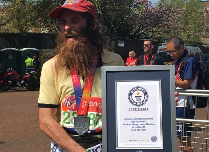 The fastest marathon in film character costume (male) is 2 hours 36 minutes 28 seconds by Rob Pope (UK), dressed as Forrest Gump at London Marathon 2018