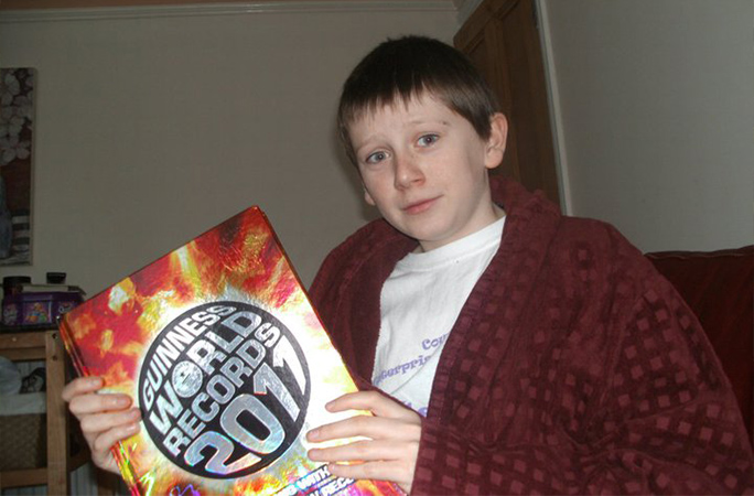 A young Jack with a copy of Guinness World Records 2011