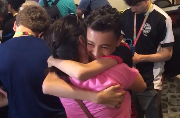Jaden-hugging-his-mum-after-winning-second-place-youngest-gamer-to-earn-1-million-in-eSports-winnings.jpg