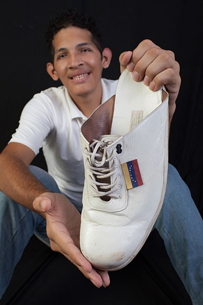8fa11453f43 Customised shoes made for man with the largest feet after they grow ...
