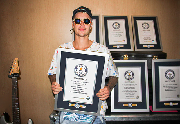 Justin Bieber with his GWR certificates