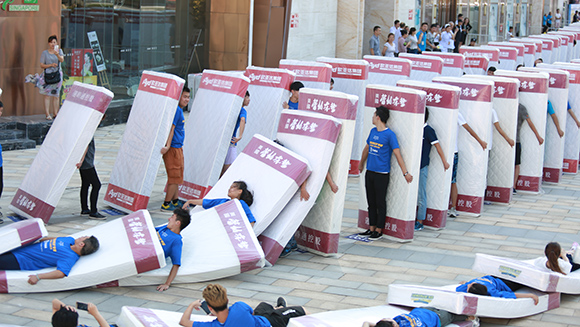 Video: Human mattress dominoes record tumbles in China