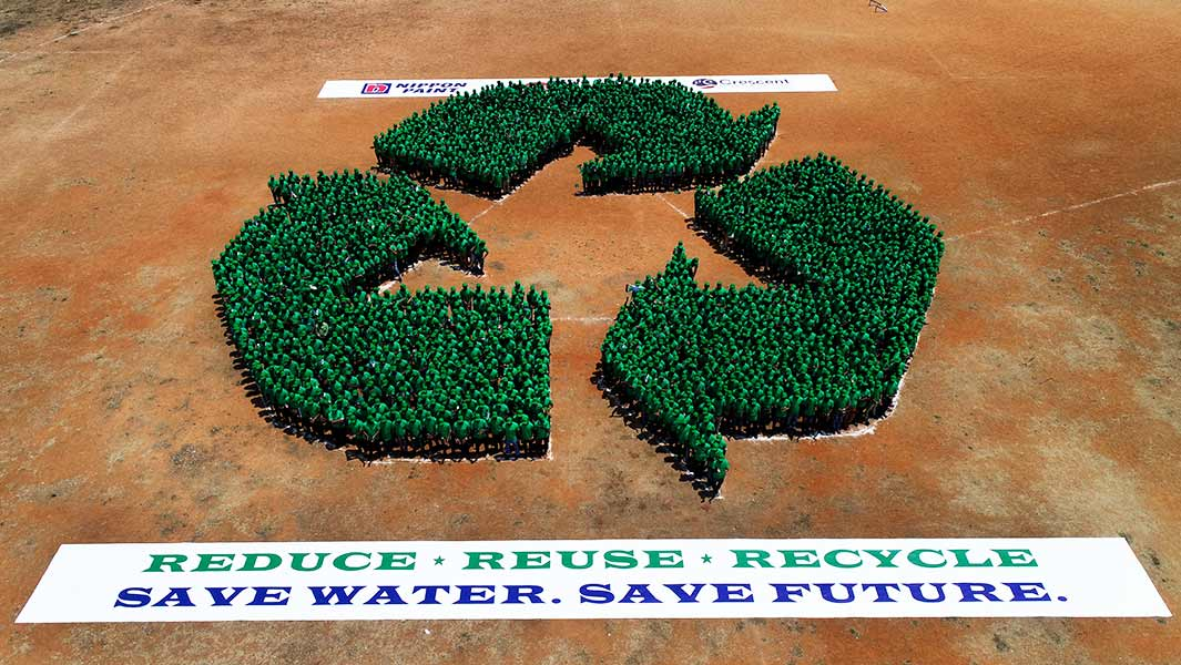 1,726 people form giant human recycling logo for record attempt in India