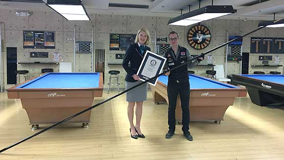 Video: Billiard star Florian Kohler makes world's longest pool cue and breaks five trick shot records