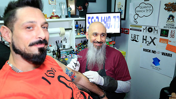 Italian tattoo artist reclaims record for 57 hour inking marathon
