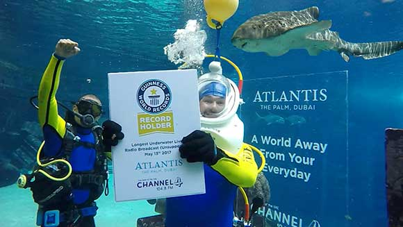 Dubai radio hosts achieves longest underwater live radio broadcast in Atlantis, The Palm aquarium