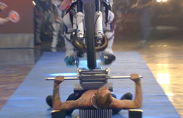 Most-Motorcycles-Driven-Over-the-Body-on-a-Bed-of-Nails-guinness-world-records-front-view