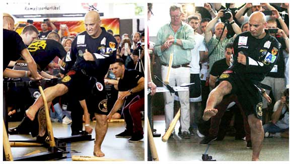 Video: German martial arts master breaks record smashing baseball bats with his shins