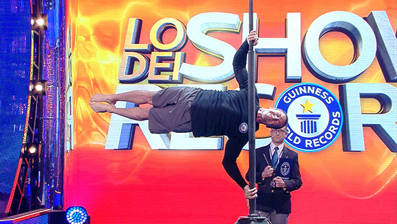 Most chin-ups in the human flag position attempt