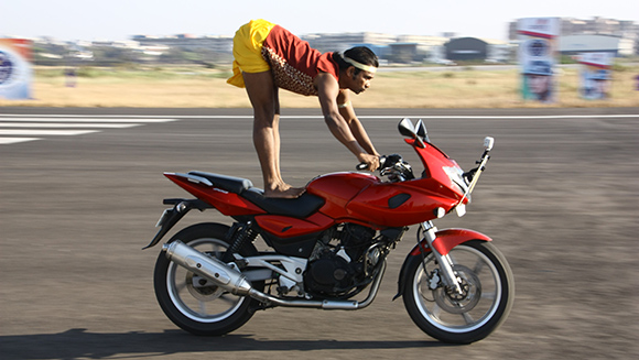 Video Classics: Indian teacher sets record performing yoga on moving motorcycle