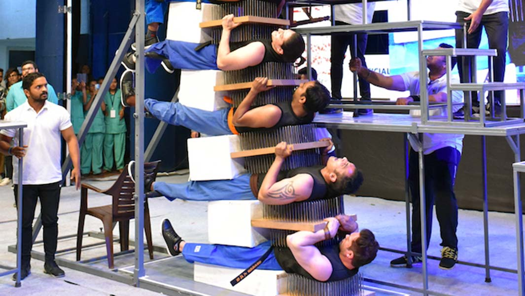 Martial arts pros form 8-layer bed of nails sandwich in record-breaking stunt