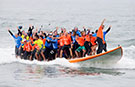 World's largest surfboard: 66 catch a wave and ride their way to a record - video