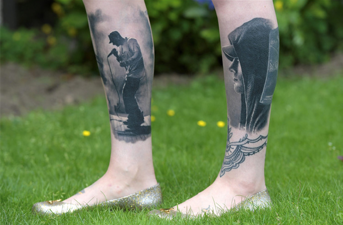 Most tattoos of the same musician tattooed on the body record holder standing on grass