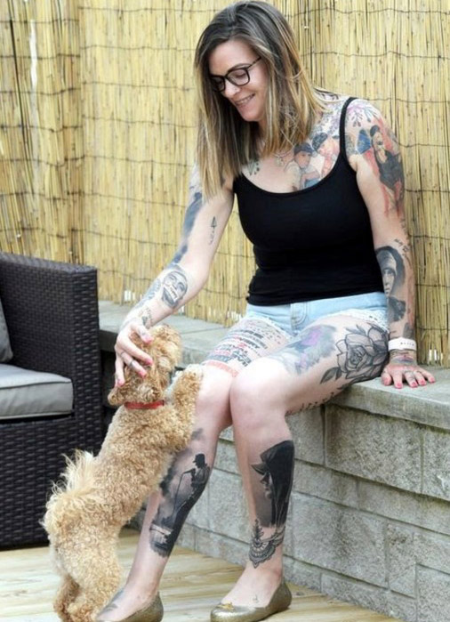 Most tattoos of the same musician tattooed on the body sitting outside petting a dog