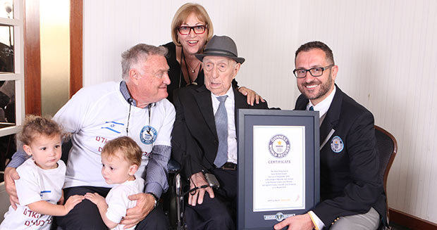 New Oldest man Israel Kristal with Marco Frigatti Head of Records son Heim Kristal daughter Shula Kuperstoch and great grandkids
