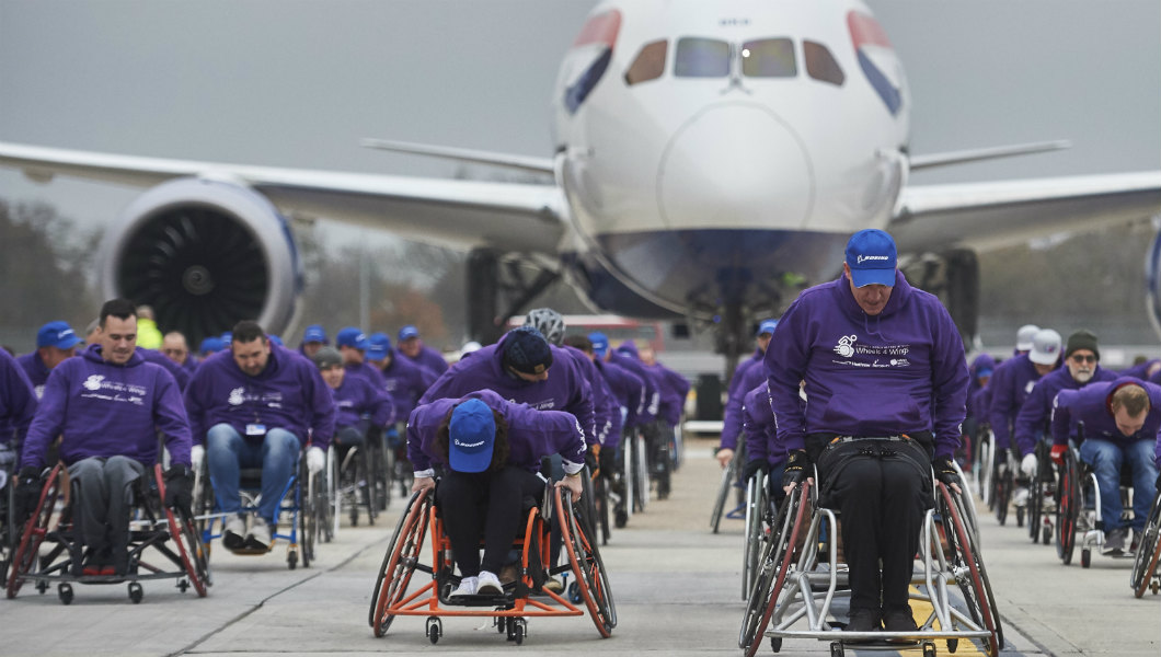 Record-breaking wheelchair team pulls plane at Heathrow to help disabled flying charity