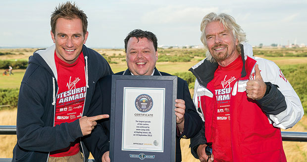 Richard Branson recieves certificate after former largest parade of kite surfers