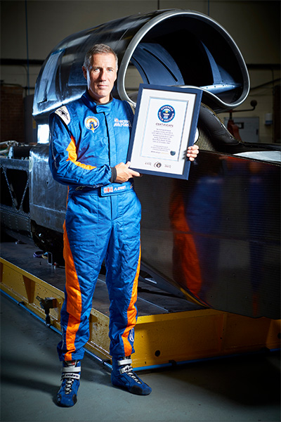 andy-green-with-his-guinness-world-records-certificate-and-thrust-ssc