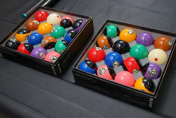 billiard-balls-colorfully-displayed-in-case-on-pool-tabl