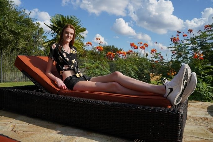 girl-with-the-longest-legs-on-lounging-chair-horizontal