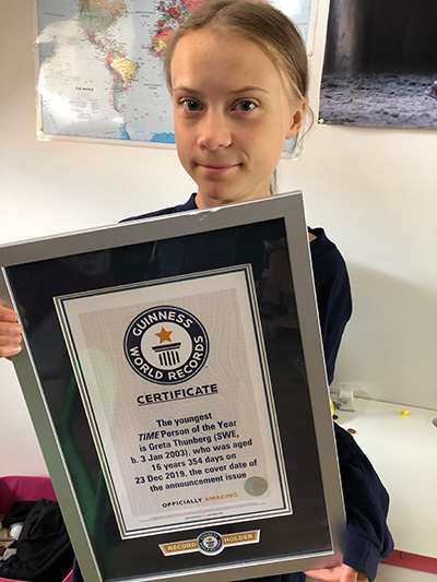 Greta with her official Guinness World Records certificate
