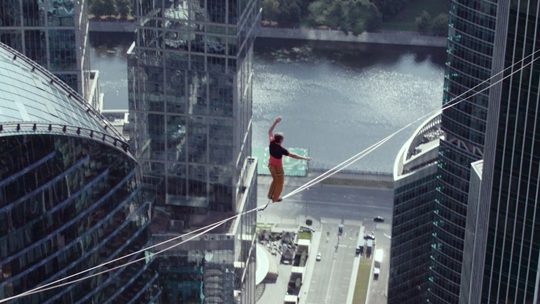 Don't look down! Daredevils walk along slackline that's higher than the Eiffel Tower