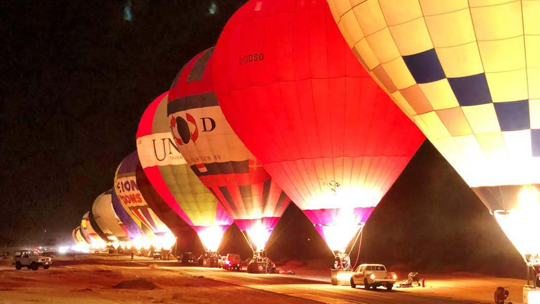 100 hot air balloons light up the skies of AlUla for spectacular glow show