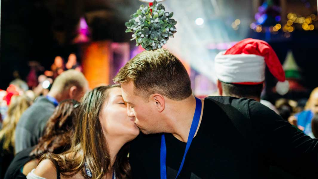 Hundreds of couples get close under the mistletoe for kissing record attempt