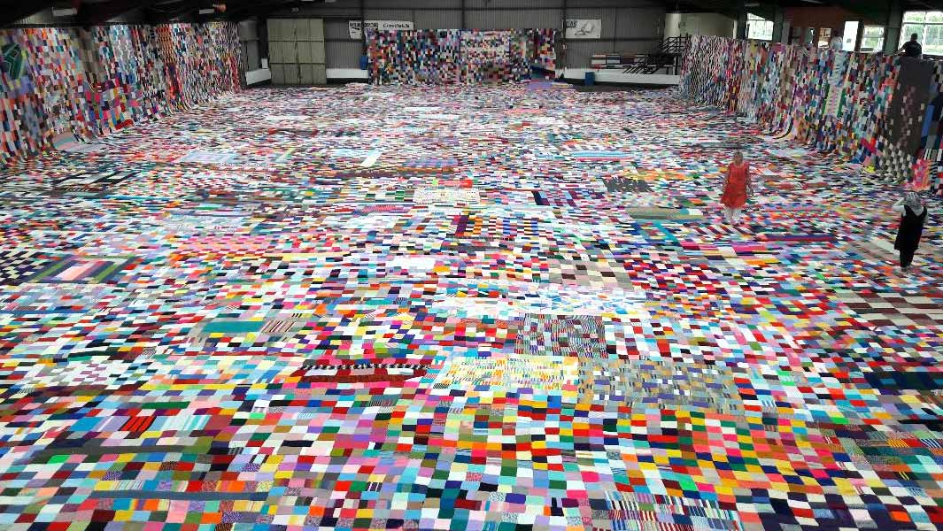 'Mad-cap idea' leads to 1,000 knitters from 32 countries creating world's largest knitted blanket