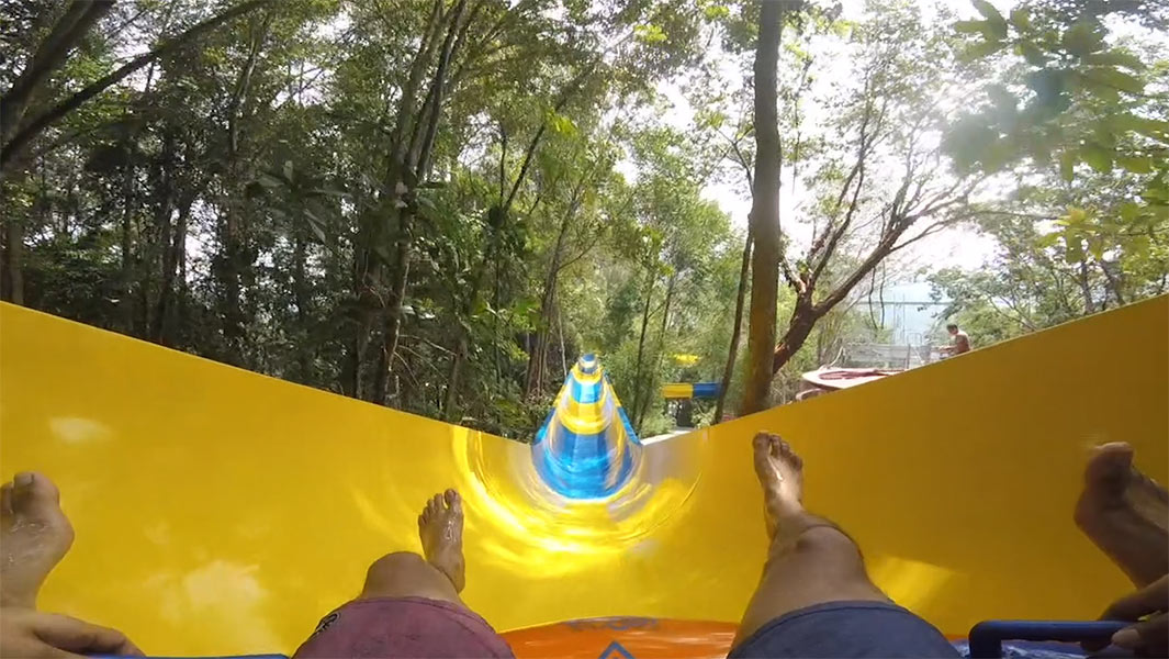 Ride through the trees on the world's longest mat water slide – all 1,111 m of it