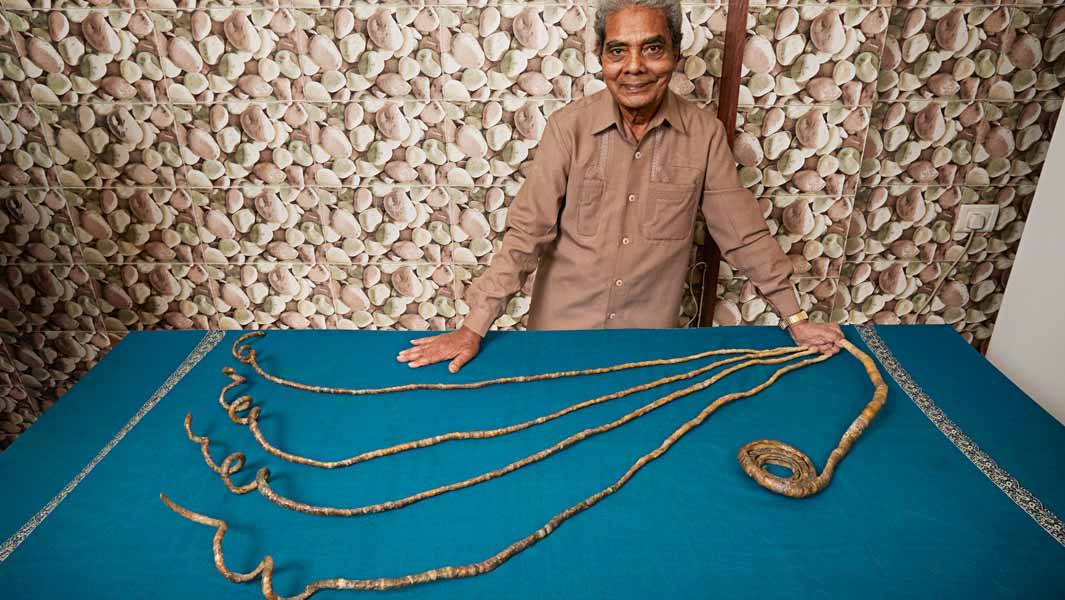 Owner of world's longest nails has them cut after growing them for 66 years