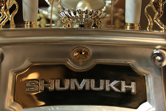 Most diamonds set on a perfume bottle Shumukh logo