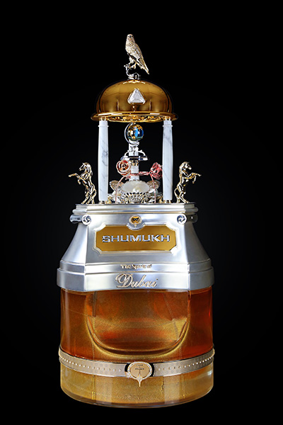Most diamonds set on a perfume bottle Shumukh front