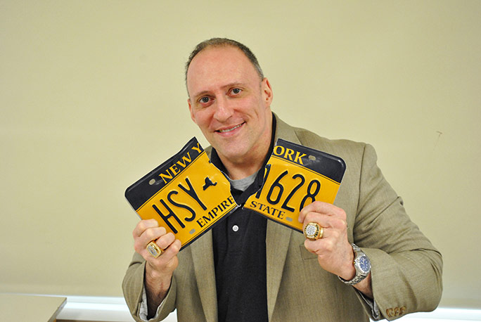 Most license plates torn in one minute Bill Clark
