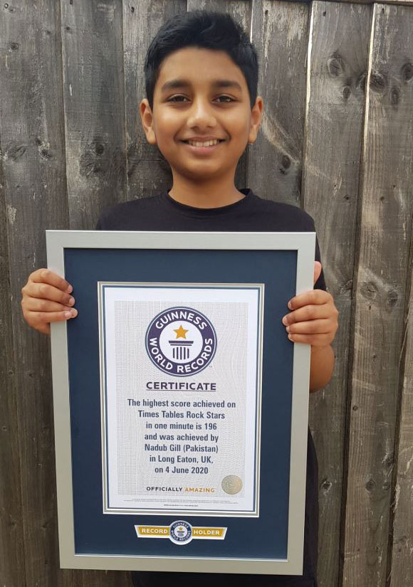 Nadub holding his Guinness World Records Certificate