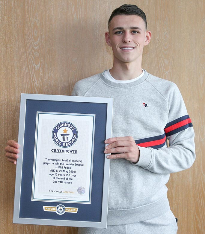phil-foden-with-certificate.jpg