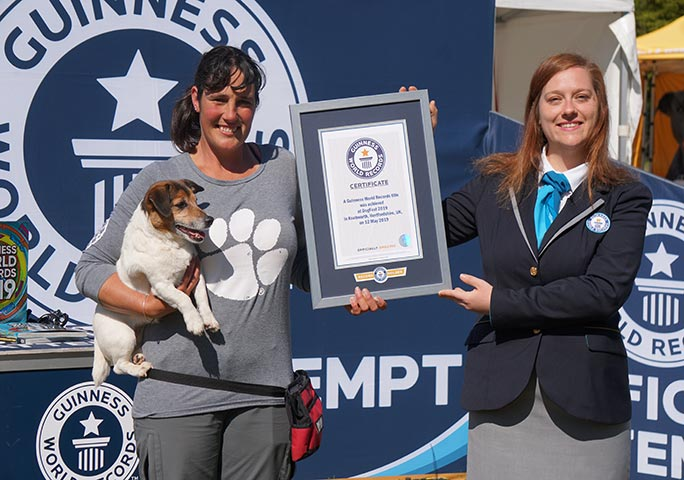 GWR adjudicator Sheila Mella presents Rachael and Jacob with an official certificate after their paw-shaking feat