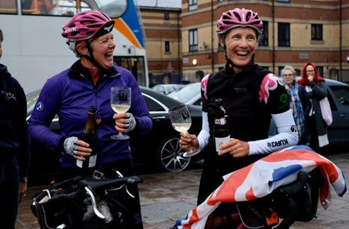Raz and Cat celebrating with prosecco back in the UK after finishing their journey