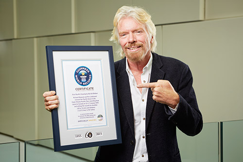 Richard Branson with certificate