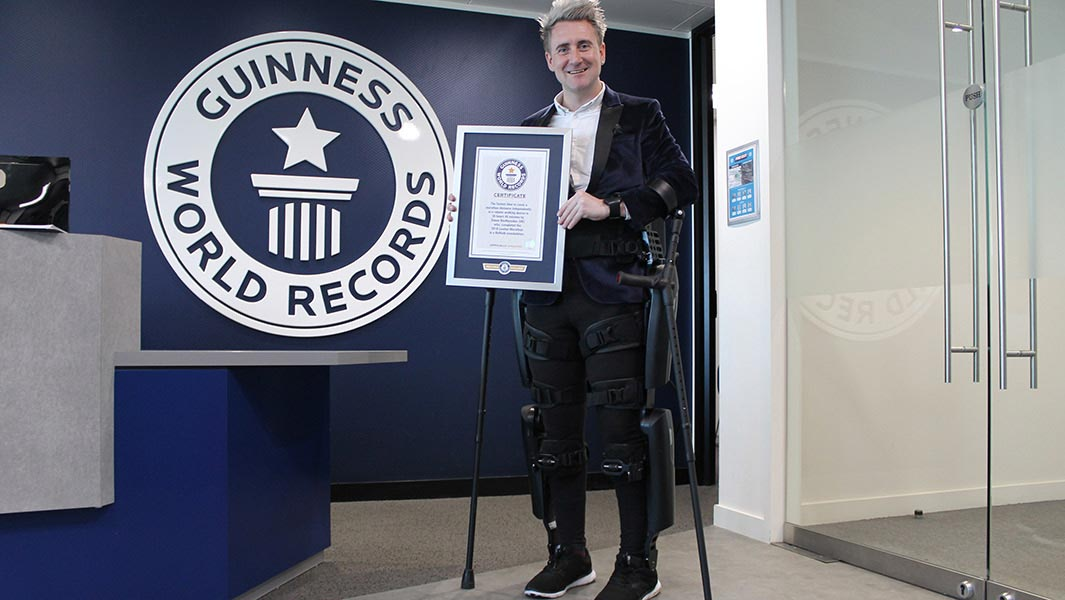Meet the disabled man who got a robotic walking device then completed a marathon