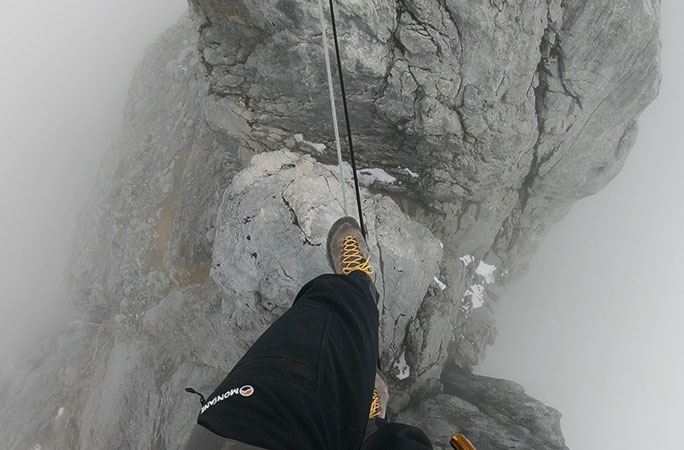 Steven walking across the Tyrolean traverse along Carstensz summit ridge