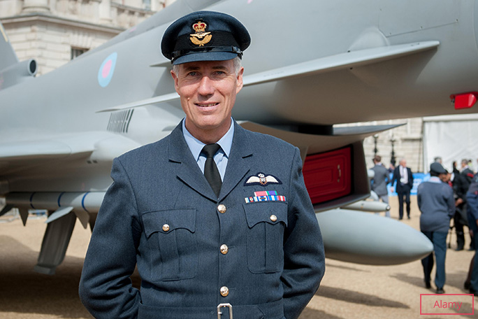 Wing Commander Green poses with a Eurofighter Typhoon at an event held to mark the RAF's 100th anniversary