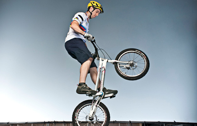 Most bars jumped on the back wheel of a trial bike