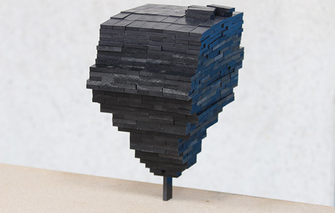 Most dominoes stacked on single piece