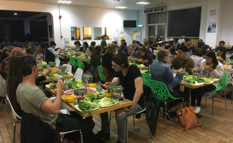 Most nationalities in a traditional Chinese hot pot dinner